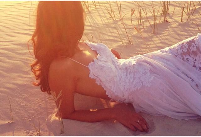 Breathtaking beach lace wedding dress with stunning low for Beach wedding dress low back