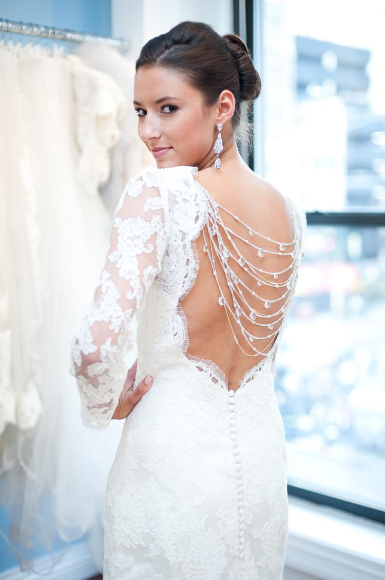 Elegant white lace long sleeved wedding dress with back for Lace white wedding dress