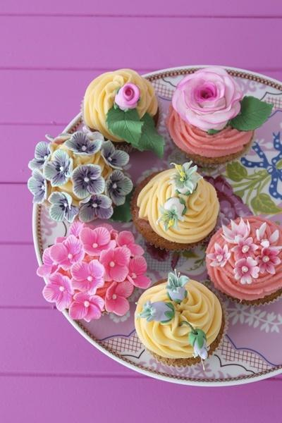 Wedding - Pretty Cupcakes  with edible blossoms on the top.
