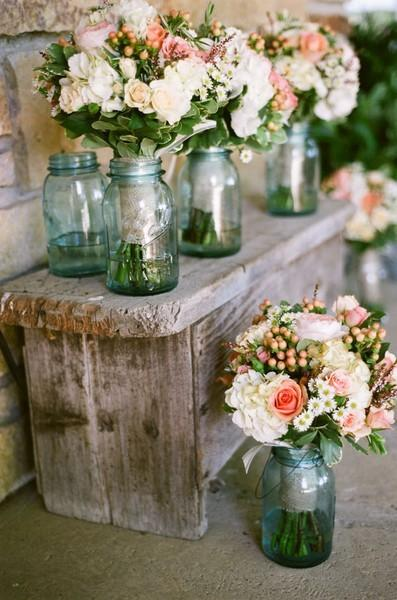 Just take the following rustic wedding centerpieces, for example, which all brought pastoral vibes to their tabletops. Ultimately, the vessel you choose impacts the style of the arrangement.