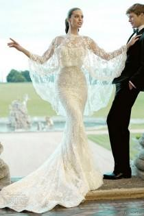 wedding photo - White wedding gown fully decorated with laces