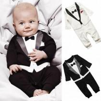 wedding photo - Cutest Ring Bearer Ever with Black And White Tuxedo